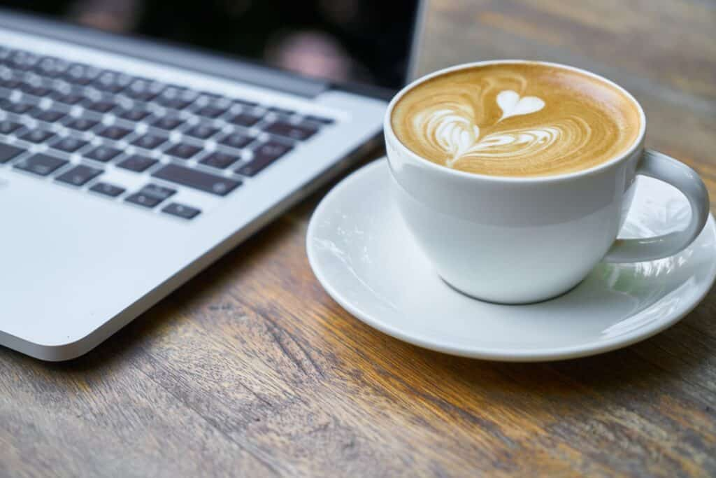 Coffee next to laptop